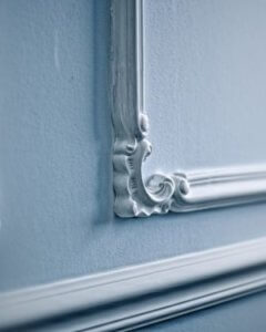 intricate wall moulding in white
